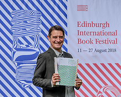 Pictured: Nick Barley Festival Director with the programme.<br /> <br /> The programme for the 2018 Edinburgh International Book Festival was launched in Edinburgh today (Thursday).<br /> <br /> &copy; Dave Johnston / EEm