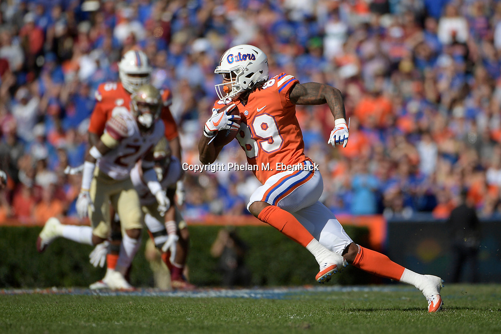 Florida wide receiver Tyrie Cleveland (89) runs after catching a pass during the first half of an NCAA college football game against Florida State Saturday, Nov. 25, 2017, in Gainesville, Fla. (Photo by Phelan M. Ebenhack)