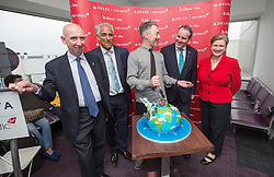 Alan Cumming, cuts the cake, as Delta launches their year-round nonstop service from Edinburgh to New York-JFK today at Edinburgh Airport.
