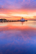 Manteno lighthouse and waterfron sunrise Roanoke Island on the Outer Banks of NC.