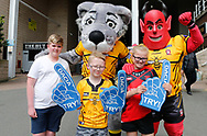 Fans of Salford Red Devils pose for a photo alongside there mascots ahead of the fixture against Catalans Dragons during the Betfred Super League match at the Dacia Magic Weekend, St. James's Park, Newcastle<br /> Picture by Stephen Gaunt/Focus Images Ltd +447904 833202<br /> 20/05/2018