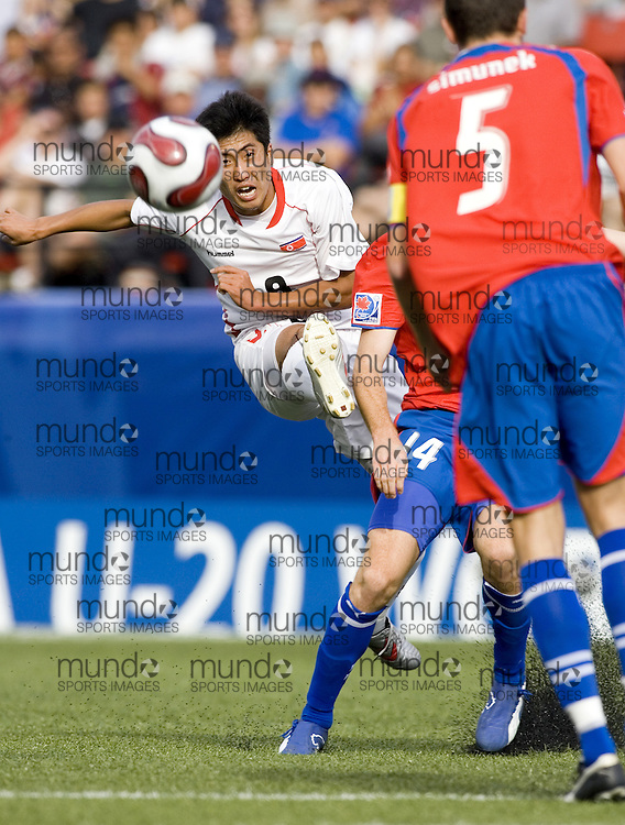03 July 2007 (Ottawa--Canada) -- The Democratic People's Republic of Korea -- North Korea (PRK) -- ties the Czech Republic (CZE) 2-2 in the group stage of the FIFA U-20 World Cup of Football...Chol Myong RI..Photo credit Sean Burges/Mundo Sport Images.