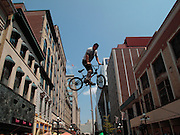 Circus performer basking on Sparks Street in Ottawa, ON, Canada on August 5, 2010. Sparks Street is a tourist attraction and the place for performers of all sorts in downtown of Ottawa, the Capital of Canada.
