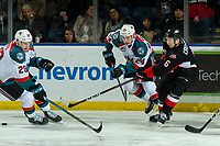 KELOWNA, CANADA - JANUARY 4:  Kyle Topping #24 of the Kelowna Rockets checks Austin Crossley #6 of the Prince George Cougars as he passes the puck during second period on January 4, 2019 at Prospera Place in Kelowna, British Columbia, Canada.  (Photo by Marissa Baecker/Shoot the Breeze)