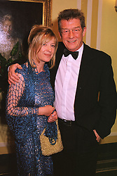 Actor JOHN HURT and his close friend SARAH OWENS, at a dinner in London on 4th March 1999.MPA 39
