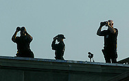 A 10.5 MG IMAGE OF:. 9/11/02 A Service Service ERT (emergency Response Team), watches on the roof of the Pentagon on the monring of September 11, 02.  Photo by Dennis Brack