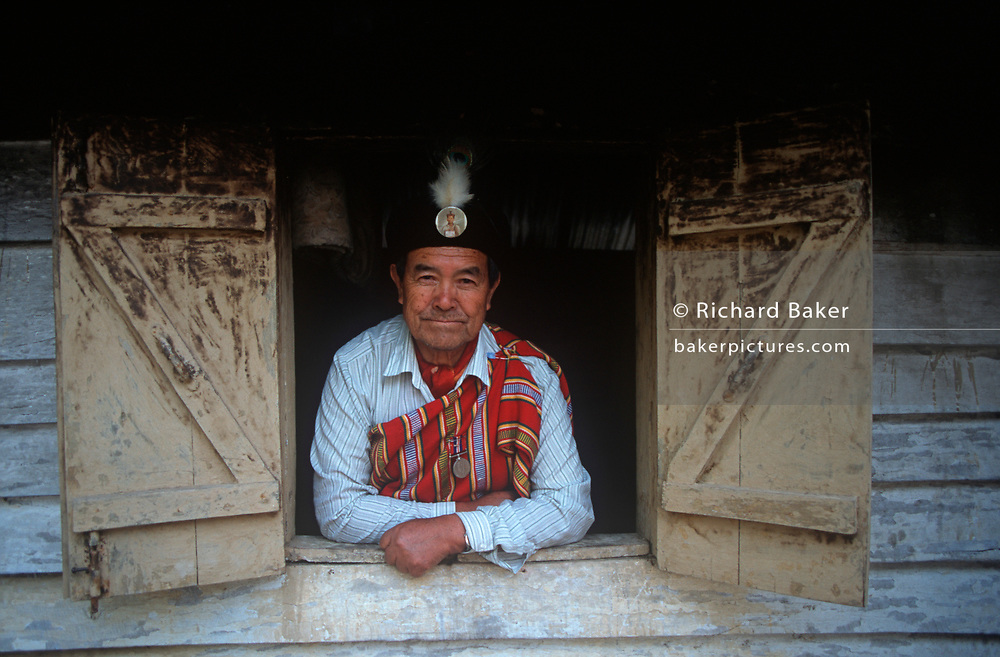 "An elderly gentleman of the indigenous Lepcha people looks through a window of his house, on 18th June 1995, in Kalimpong, West Bengal, India. The Lepcha are also called the Rongkup meaning the children of God and the Rong, Mútuncí Róngkup Rumkup ""beloved children of the Róng and of God""), and Rongpa are among the indigenous peoples of Sikkim, India and number between 30,000 and 50,000. Many Lepcha are also found in western and southwestern Bhutan, Tibet, Darjeeling, the Mechi Zone of eastern Nepal, and in the hills of West Bengal. (Photo by Richard Baker / In Pictures via Getty Images)"