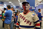 May 13, 2015 - New York, NY. Eddie Hawkins had his face painted in preparation for game 7 of the Rangers-Capitals series at Madison Square Garden.  Photograph by Anthony Kane/NYCity Photo Wire