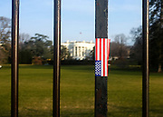 © Licensed to London News Pictures. 02/01/2013. Washington DC, USA .  A sticker of the Stars and Stripes flag on the railings surrounding the South Lawn of The White House.  Photo credit : Stephen Simpson/LNP