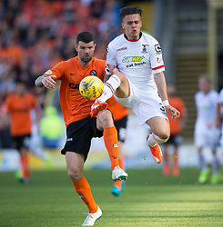 Dundee United&rsquo;s Mark Durnan and Inverness Caledonian Thistle's Miles Storey.<br /> Half time : Dundee United 1 v 0 Inverness Caledonian Thistle, SPFL Ladbrokes Premiership game played 19/9/2015 at Tannadice.