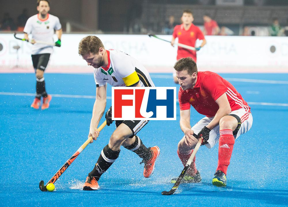 BHUBANESWAR - The Odisha Men's Hockey World League Final . Match ID 01 . Germany v England (2-0). Martin Haener (Ger) with Liam Ansell (Eng)    .WORLDSPORTPICS COPYRIGHT  KOEN SUYK