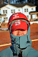 Angkana Bode's ready for a chilly morning on the Build-A-Block Habitat for Humanity project.