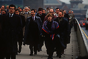 1990s rush-hour commuters cross London Bridge from Southwark on the south bank to the City of London (aka The Square Mile), the capital's financial centre, on 18th February 1992, in London, England.