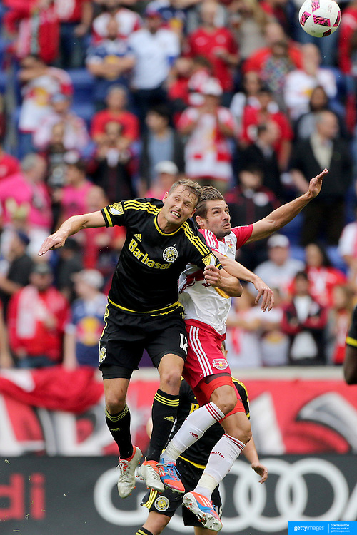 HARRISON, NEW JERSEY- OCTOBER 16:  Adam Jahn #12 of Columbus Crew is challenged by Damien Perrinelle #55 of New York Red Bulls during the New York Red Bulls Vs Columbus Crew SC MLS regular season match at Red Bull Arena, on October 16, 2016 in Harrison, New Jersey. (Photo by Tim Clayton/Corbis via Getty Images)