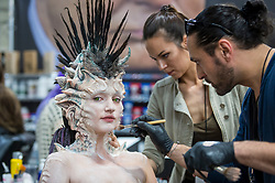 © Licensed to London News Pictures. 18/05/2019. LONDON, UK.  Make-up artists work on a model at the International Make-Up Artists Trade Show (IMATS) taking place at Kensington Olympia 16 to 19 May 2019.  The show brings together make-up artists from around the world, including those with Hollywood movie backgrounds, providing classes in theatre, film, TV, fashion and editorial make-up to professionals and enthusiasts.  Photo credit: Stephen Chung/LNP