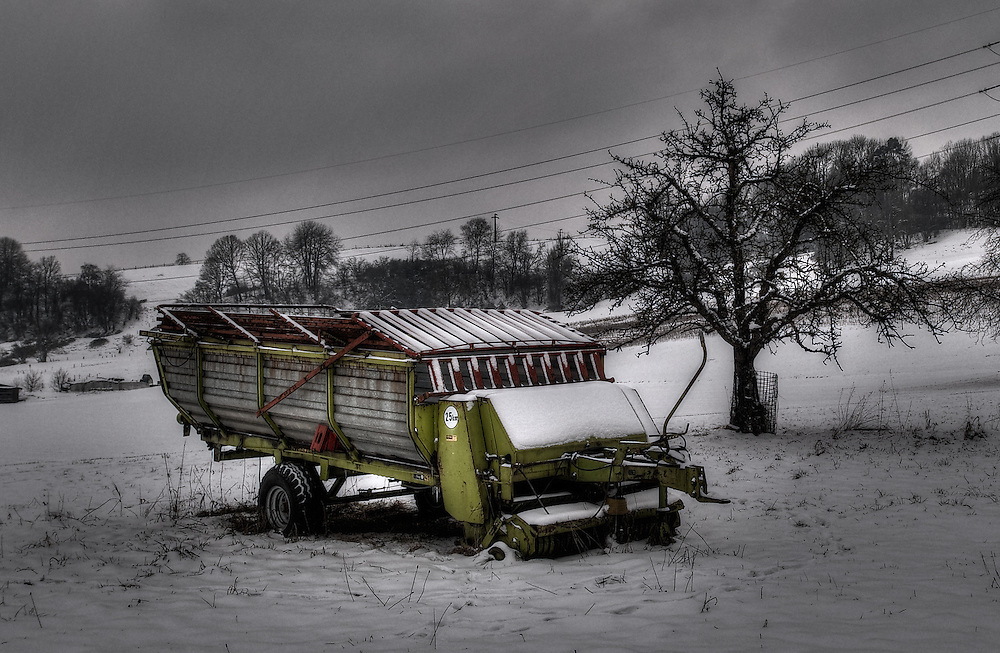 Agricultural machinery on snow covered medow in Embrach