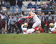 Lafayette High's John Chance (77) tackles Forrest County AHS' Dontavian Lee (32) in the MHSAA Class 4A championship game at Mississippi Veterans Memorial Stadium in Jackson, Miss. on Saturday, December 7, 2013. Forrest County AHS won 21-6.