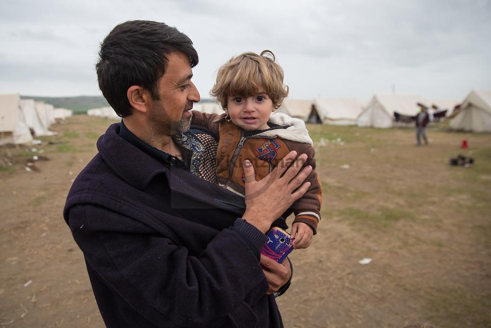 Nea Kavala, Greece - 23.03.2016  <br /> <br /> 3,515 refugees are currently living in the official Greek refugee camp in Nea Kavala. The Greek military opened the 600 tents big camp about 1 month ago. The conditions in the camp are meager : In case of rain the area is partially submerged also the tents are not heated .<br /> <br /> 3.515 Fluechtlinge leben derzeit in dem offiziellen griechischen Fluechtlingscamp in Nea Kavala. Das griechische Militaer er&ouml;ffnete das aus 600 Zelten bestehende Lager etwa 1 Monat vorher. Die Bedingungen im Lager sind d&uuml;rftig: Bei Regen steht das Gelaende teilweise unter Wasser au&szlig;erdem sind die Zelte nicht geheizt.
