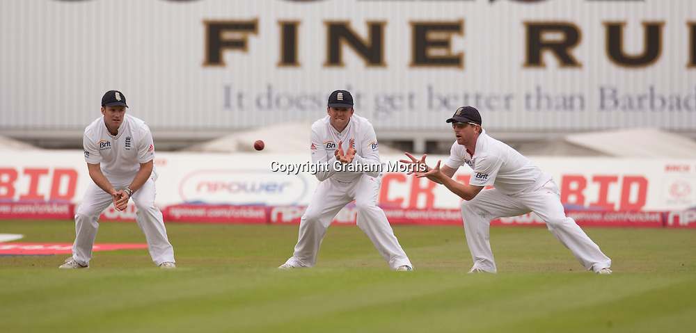Andrew Strauss (left) and Graeme Swann watch as Paul Collingwood (right) catches Umar Amin during the second npower Test Match between England and Pakistan at Edgbaston, Birmingham.  Photo: Graham Morris (Tel: +44(0)20 8969 4192 Email: sales@cricketpix.com) 06/08/10