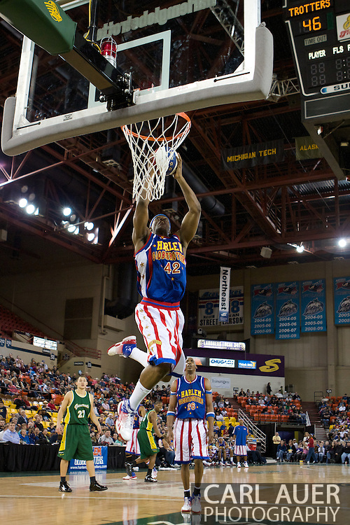 April 30th, 2010 - Anchorage, Alaska:  Harlem Globetrotter Titan (42) skies to the rim with a two handed dunk.