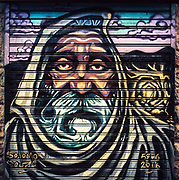 """This special series showcases the wonderful wall murals that adorn the stall doors of the Mehane Yehuda market (the """"shuk"""" or """"souk"""") in Jerusalem.  This murals were painted by Solomon Souza pursuant to a project that has transcended the market into one of the hottest spots in Jerusalem in the day and also deep into the night.  These photographs are not mere snap shots, but rather proper portraits taken with my Hasselblad Superwide camera and special highly saturated color slide film (Fuji Velvia and Provia).  As striking as these murals are in person, these photos further accentuate their beauty.  These photos can be printed very large and would look dynamite on Fuji Flex high gloss photo paper and face mounted on plexiglass-glass. This is a special series that captures the soul of the wonderful Mehane Yehuda market (the """"shuk"""") in Jerusalem, Israel."""