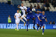 Sol Bamba of Cardiff city gets to the ball ahead of Ezgjan Alioski of Leeds Utd. EFL Skybet championship match, Cardiff city v Leeds Utd at the Cardiff city stadium in Cardiff, South Wales on Tuesday 26th September 2017.<br /> pic by Andrew Orchard, Andrew Orchard sports photography.