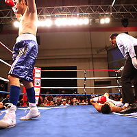 "Former WBO World champion Alex ""El Nene"" Sanchez (White Trunks) of Ponce, Puerto Rico lays on the ground during the count after being knocked down in round 2  at the Kissimmee Civic Center in Kissimmee, Florida, on Friday, Dec 9, 2011.  Donaire won the bout when Sanchez injured his left wrist and failed to come out in the ninth round. (AP Photo/Alex Menendez)"