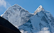 Sagarmatha National Park, Nepal: Kangtega (left, 21,932 feet / 6685 meters) and Thamserku (right, 21,680 feet / 6608 meters) in the Khumbu District of Nepal, are part of the Himalaya Mountain Range in High Asia. Sagarmatha National Park was created in 1976 and honored as a UNESCO World Heritage Site in 1979.
