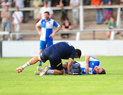 Bristol Rovers' Fabian Broghammer receives treatment to his leg - Photo mandatory by-line: Dougie Allward/JMP - Tel: Mobile: 07966 386802 16/07/2013 - SPORT - FOOTBALL - Bristol -  Hereford United V Bristol Rovers - Pre Season Friendly