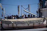 Waiting to land in the Pozzallo harbor, one of the most used for giving first assistance to the migrants that Italian navy ships rescue in the Mediteranean sea. 358 people 6 women 1 child, 272 from Bangladesh 61 syria, 3 India, 7 Sudan, 5 Palestine, 1 Guinea, 4 Ghana, 2 Marocco