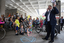 London, UK. 17 July, 2019. Cllr Stephen Cowan, Leader of the London Borough of Hammersmith and Fulham, declares a climate emergency as he addresses climate activists from Extinction Rebellion assembled outside Hammersmith Town Hall following a Critical Mass bicycle ride from Waterloo Millennium Green on the third day of their 'Summer uprising'. The activists have three demands for Hammersmith and Fulham Council: to pass the proposed motion to declare a Climate Emergency; to keep Hammersmith bridge closed to vehicles; and to commit to safer cycling routes.