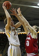 December 31 2012: Iowa Hawkeyes center Adam Woodbury (34) puts up a shot over Indiana Hoosiers forward Cody Zeller (40) during the first half of the NCAA basketball game between the Indiana Hoosiers and the Iowa Hawkeyes at Carver-Hawkeye Arena in Iowa City, Iowa on Monday December 31, 2012. Indiana defeated Iowa 69-65.