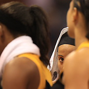 Skylar Diggins, Tulsa Shock, peers out from the team huddle at the end of the game after the Connecticut Sun V Tulsa Shock WNBA regular game at Mohegan Sun Arena, Uncasville, Connecticut, USA. 2nd July 2013. Photo Tim Clayton