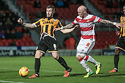 Richard Chaplow (Doncaster Rovers) and Michael O'Connor (Port Vale) challenge for the ball during the Sky Bet League 1 match between Doncaster Rovers and Port Vale at the Keepmoat Stadium, Doncaster, England on 26 January 2016. Photo by Mark P Doherty.