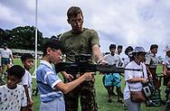 Hong Kong. farewell of the  - Black watch -  (British army) at Stanley fort  tug of war, beating retreat   / Journée d'adieu du bataillon écossais   - Black Watch -   à Fort Stanley: démonstration des armes aux enfants  / R00057/59    L940626  /  P0000310