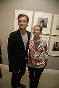 JUDE LAW AND HIS SISTER NATASHA LAW, Photos by Robert Mapplethorpe: Still Moving & Lady, Alison Jacques Gallery, 4 Clifford Street, London, W1, Dinner afterwards at the  The Dorchester with performance by Patti Smith, 7 September 2006.  ONE TIME USE ONLY - DO NOT ARCHIVE  © Copyright Photograph by Dafydd Jones 66 Stockwell Park Rd. London SW9 0DA Tel 020 7733 0108 www.dafjones.com