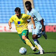 Picture by Alex Broadway/Focus Images Ltd.  07905 628187.30/7/11.Gael Bigirimana of Coventry City and Wes Hoolahan of Norwich City during a pre season friendly at The Ricoh Arena, Coventry.