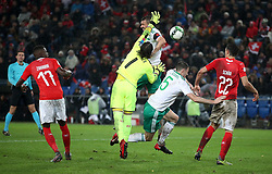Northern Ireland's Gareth McAuley directs a header on goal, under pressure from Switzerland goalkeeper Yann Sommer during the FIFA World Cup Qualifying second leg match at St Jakob Park, Basel.