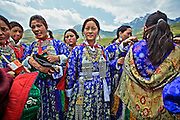 Ladakhi Dancers wearing traditional Ladakhi outfit in Dras, a small town of Kargil District which got famous after the Kargil War of 1999.