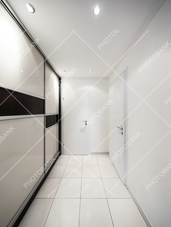 Entrance of a modern apartment, corridor with wardrobes