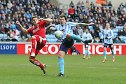 Coventry City forward Darius Henderson (44)  has a shot in the 80th minute charged down by Swindon Town defender Jamie Sendles-White (21)   during the Sky Bet League 1 match between Coventry City and Swindon Town at the Ricoh Arena, Coventry, England on 19 March 2016. Photo by Simon Davies.