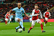 Vincent Kompany (4) of Manchester City battles for possession with Shkodran Mustafi (20) of Arsenal during the EFL Cup Final match between Arsenal and Manchester City at Wembley Stadium, London, England on 25 February 2018. Picture by Graham Hunt.
