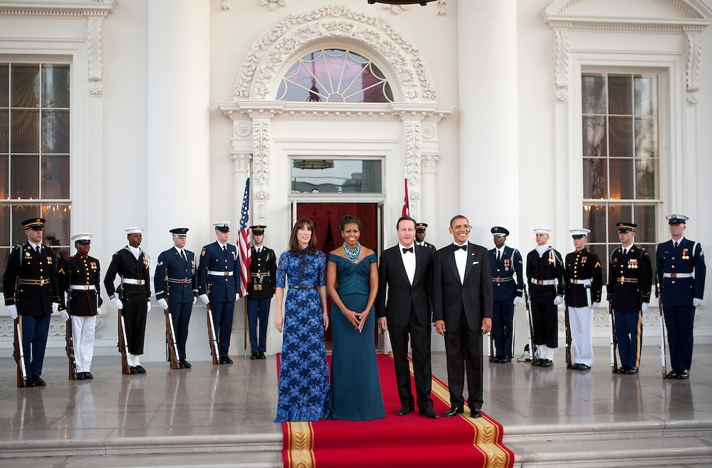 U.S. President Barack Obama and First Lady Michelle Obama greet David Cameron, prime minister of Great Britain, and his wife Samantha as they arrive for a State Dinner at the White House in Washington, D.C., U.S., on Wednesday, March 14, 2012. Photographer: Joshua Roberts/Bloomberg