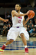 DALLAS, TX - JANUARY 21: Nick Russell #12 of the SMU Mustangs brings the ball up court against the Rutgers Scarlet Knights on January 21, 2014 at Moody Coliseum in Dallas, Texas.  (Photo by Cooper Neill/Getty Images) *** Local Caption *** Nick Russell