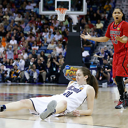 Apr 9, 2013; New Orleans, LA, USA; Connecticut Huskies forward Breanna Stewart (30) is fouled by Louisville Cardinals forward Monique Reid (33) during the first half of the championship game in the 2013 NCAA womens Final Four at the New Orleans Arena. Mandatory Credit: Derick E. Hingle-USA TODAY Sports