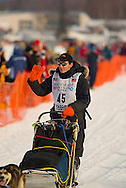 05 March 2006: Willow, Alaska - Ryan Redington, Grandson of Iditarod founder, Joe Redington waves to the fans during the restart of the 2006 Iditarod on Willow Lake in Willow, Alaska