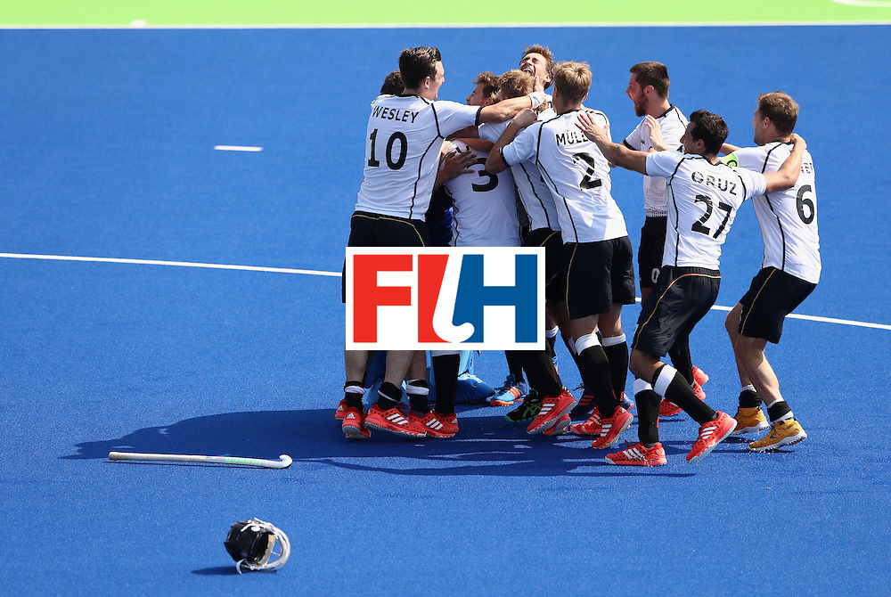 RIO DE JANEIRO, BRAZIL - AUGUST 18:  Germany celebrate after the bronze medal in a penalty shoot out during the Men's Bronze Medal match between the Netherlands and Germany on Day 13 of the Rio 2016 Olympic Games held at the Olympic Hockey Centre on August 18, 2016 in Rio de Janeiro, Brazil.  (Photo by David Rogers/Getty Images)