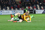 Olliver McBurnie  of Newport County watches Paul Robinson of AFC Wimbledon convert the ball into his own net during the Sky Bet League 2 match between Newport County and AFC Wimbledon at Rodney Parade, Newport, Wales on 19 December 2015. Photo by Stuart Butcher.