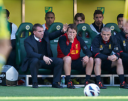 NORWICH, ENGLAND - Saturday, September 29, 2012: Liverpool's manager Brendan Rodgers salutes travelling supporters during his side's 5-2 victory over Norwich City during the Premiership match at Carrow Road. (Pic by David Rawcliffe/Propaganda)