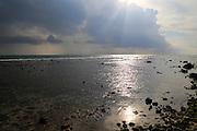 Storm clouds and rain passing over ocean Pasikudah Bay, Eastern Province, Sri Lanka, Asia